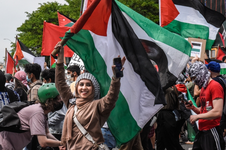 People participate in a pro-Palestinian rally on May 22, 2021 in the Queens borough of New York City [Stephanie Keith/ Getty Images]