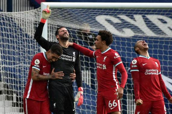 Liverpool's Brazilian goalkeeper Alisson Becker, second from left, celebrates scoring his team's second goal at The Hawthorns stadium in West Bromwich [Rui Vieira /AFP]