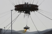 A lander is seen during a hovering-and-obstacle avoidance test for China's Mars mission at a test facility in Huailai, Hebei province, China in 2019 [File: Jason Lee/Reuters]