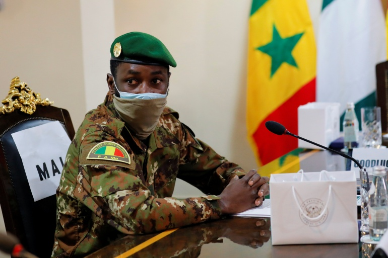 Colonel Goita, the Malian military leader, was at the ECOWAS crisis summit in Ghana on Sunday to argue the military's case but has now returned to Mali [File: Francis Kokoroko/Reuters]