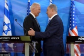 Then-US Vice President Joe Biden (left) shakes hands with Israeli Prime Minister Benjamin Netanyahu in Jerusalem on March 9, 2016 [File: Debbie Hill/Pool via Reuters]