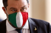 During his 14 months as interior minister, Salvini stopped several boats from docking in Italy in an effort to halt migrants and refugees entering the country [File: Guglielmo Mangiapane/Reuters]