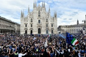 Inter Milan fans celebrate winning Italian football's Serie A outside the Duomo di Milano [Flavio Lo Scalzo/Reuters]