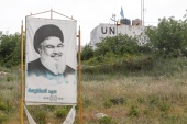 A poster depicting Lebanon's Hezbollah leader Sayed Hassan Nasrallah is seen in Marwahin, southern Lebanon [Aziz Taher/Reuters]