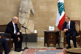 Lebanon's President Michel Aoun, right, meets with French Foreign Minister Jean-Yves Le Drian at the presidential palace in Baabda, Lebanon [Dalati Nohra/Handout via Reuters]