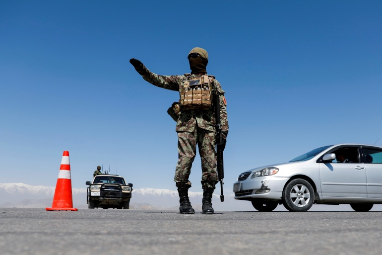 An Afghan National Army soldier stands guard at a checkpoint on the outskirts of Kabul, Afghanistan, April 21, 2021 [File: Reuters]