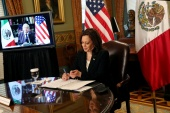 Vice President Kamala Harris holds a virtual bilateral meeting from Washington with Mexico's President Andres Manuel Lopez Obrador discussing migration and corruption on May 7, 2021 [Leah Millis/Reuters]