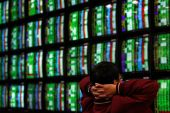 Analysts doubt broader equity sell-off will extend much further [File: Nicky Loh/Reuters]