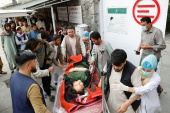 An injured woman is transported to a hospital after a blast in Kabul [Mohammad Ismail/Reuters]