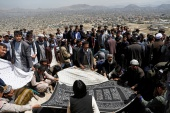 Relatives attend a mass funeral ceremony for victims of yesterday's explosion in Kabul [Reuters]