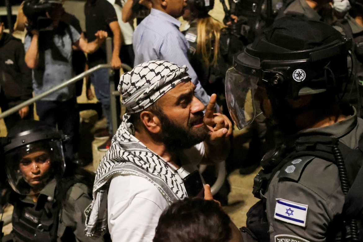 A Palestinian confronts an Israeli policeman by the entrance to Jerusalem's Old City. [Ronen Zvulun/Reuters]
