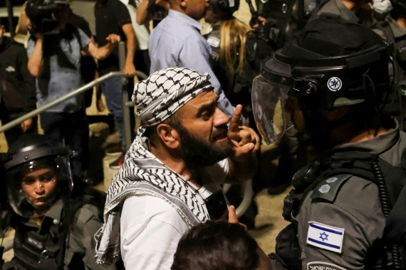 A Palestinian man argues with an Israeli border policeman by the entrance to Jerusalem's Old City [Ronen Zvulun/Reuters]