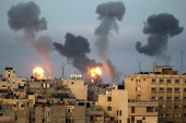 Flames and smoke rise after Israeli air strikes in the southern Gaza Strip May 11, 2021 [Ibraheem Abu Mustafa/Reuters]