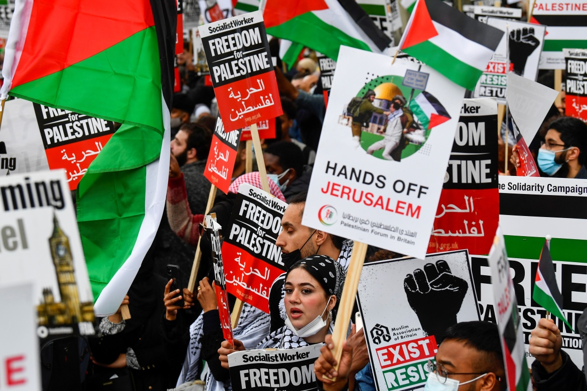 Pro-Palestinian demonstrators attend a protest following a flare-up of Israeli-Palestinian violence in London. [Toby Melville/Reuters]
