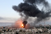 Smoke and flames rise in Gaza during Israeli air attacks amid a flare-up in violence. [Ibraheem Abu Mustafa/Reuters]
