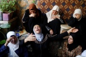 The mother of Palestinian Rasheed Abu Arra, who was killed, mourns her son alongside other women, in the town of Aqaba near Tubas, in the Israeli-occupied West Bank [Raneen Sawafta/Reuters]