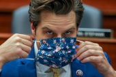 Representative Matt Gaetz dons a mask on Capitol Hill in Washington, DC at committee hearing on May 12, 2021 [File: Evelyn Hockstein/Reuters]