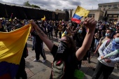 Colombian demonstrators take to the streets in anti-government protests demanding the end to police violence and greater economic support as COVID-19 rages [Nathalia Angarita/Reuters]