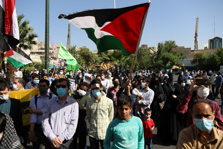 Protesters in Tehran, Iran gather in support of Palestinians [Majid Asgaripour/West Asia News Agency via Reuters]