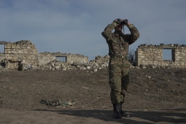 An Armenian soldier stands near the village of Taghavard in Nagorno-Karabakh [File: Artem Mikryukov/Reuters]