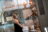 A visitor looks at exhibits of the Acropolis Museum, as museums open following the easing of measures against the spread of COVID-19 [Alkis Konstantinidis/Reuters]
