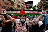 A woman participates in a protest in support of Palestinians in Madrid, Spain, on Saturday. [Juan Medina/Reuters]