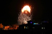Smoke and flames rise above a building during Israeli air raids on Gaza City [Mohammed Salem/Reuters]