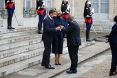 French President Emmanuel Macron and his wife Brigitte Macron welcome Ghanaian President Nana Akufo-Addo [Gonzalo Fuentes/Reuters]