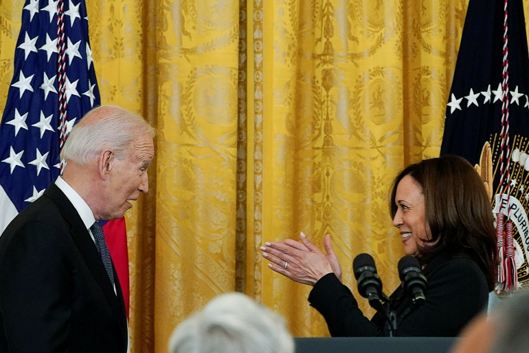 Vice President Kamala Harris and President Joe Biden applaud the COVID-19 Hate Crimes Act as the president signed it into law in a ceremony at the White House [Kevin Lamarque/Reuters]