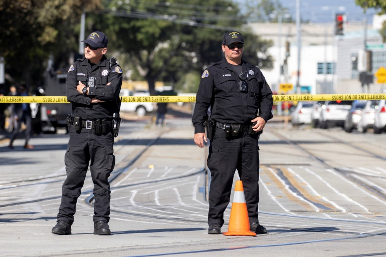 Police secure the scene of a mass shooting at a rail yard run by the Santa Clara Valley Transportation Authority in San Jose, California, May 26, 2021 [Peter DaSilva/Reuters]