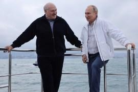 Russian President Vladimir Putin and his Belarusian counterpart Alexander Lukashenko take a boat trip off the Black Sea coast, Russia, May 29, 2021 [Sputnik/Sergei Ilyin/Kremlin via Reuters]