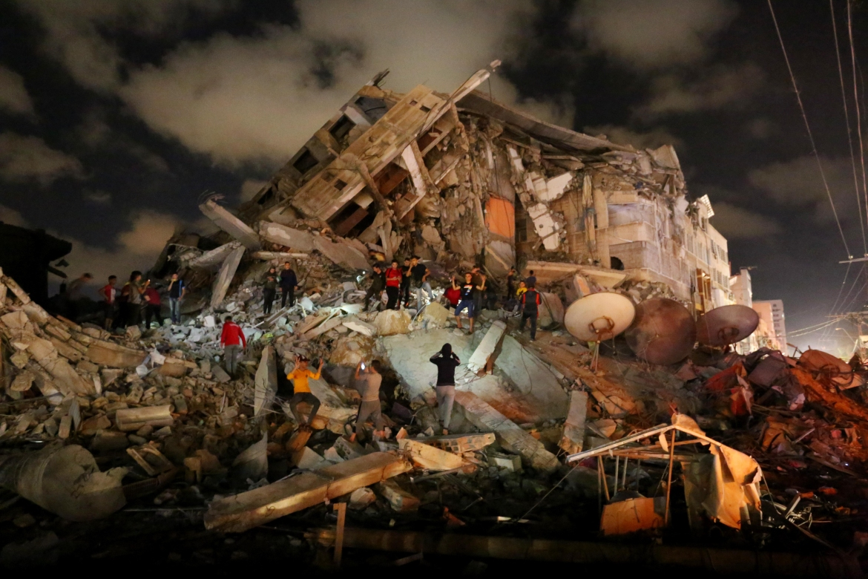 Israel's heavy bombardment of the Gaza Strip left much of the blockaded territory in ruins. [Ashraf Amra/Anadolu]