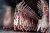 A worker moves sides of beef inside a refrigerated truck in Buenos Aires, Argentina, where annual per capita beef consumption has fallen to 48kg (106 pounds), the lowest level in data on record [File: Erica Canepa/Bloomberg]
