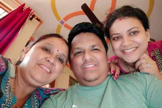 Pradeep Gusain, 29, with his wife, Karishma, and his mother, Bimla Devi, before his death from COVID-19 in April [Photo courtesy of the Gusain family]