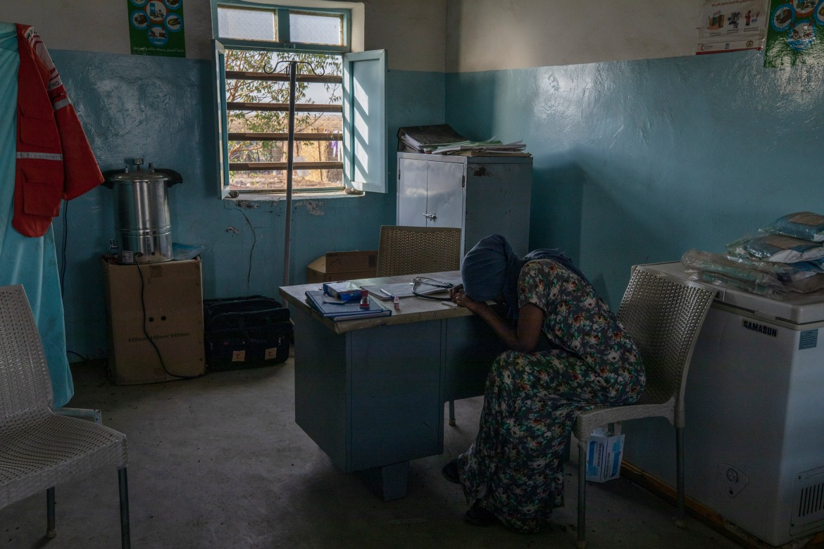 Hareg reacts after learning of her positive malaria test. [Nariman El-Mofty/AP Photo]
