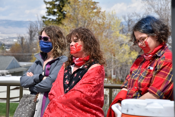 Women listen to speakers during a ceremony to commemorate missing and murdered indigenous people in front of the Montana state Capitol in Helena, Montana [Iris Samuels/The Associated Press]