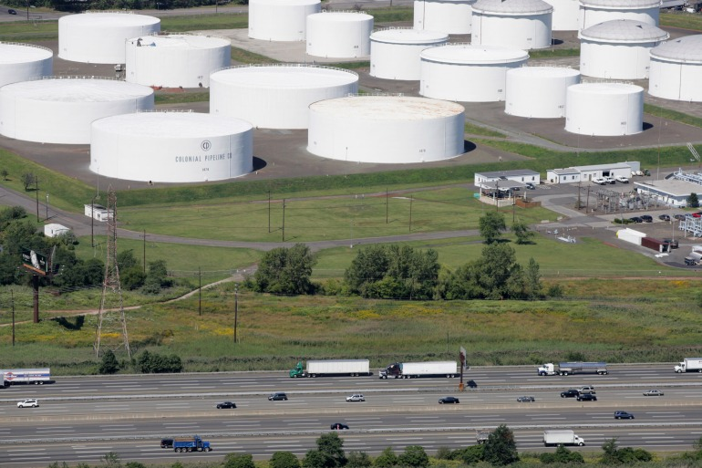 This 2008 file photo shows oil storage tanks owned by the Colonial Pipeline Company in Linden, New Jersey, US [File: Mark Lennihan/AP Photo]