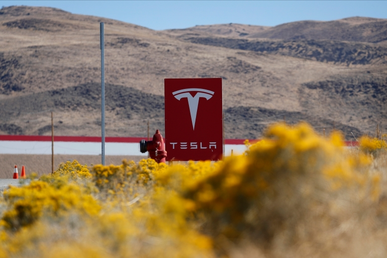 The hack was designed as a distributed denial-of-service attack, using junk data to flood the Tesla computer system so a second intrusion could let co-conspirators extract data from the company network and demand ransom [File: John Locher/AP Photo]