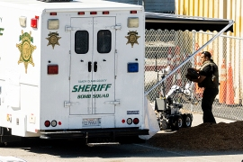 An emergency responder stows a bomb squad robot following a shooting at a Santa Clara Valley Transportation Authority (VTA) rail yard [Noah Berger/The Associated Press]