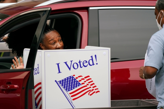 Drive-through early voting, which this Dallas, Texas voter completed last October, could be limited under Republican-backed voting changes [File: LM Otero/AP Photo]