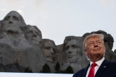 Former President Donald Trump announced his now-cancelled plan for a 'National Garden of American Heroes' during a speech at Mount Rushmore National Memorial last July [File: Alex Brandon/AP Photo]