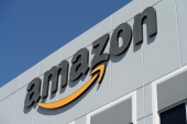 Amazon.com, Apple, Google, Microsoft and more than 20 other firms say the H-4 visa is critical to a foreign couple's decision to come to the United States, buy a home and raise children [File: John Locher/AP]