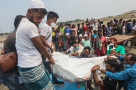 The body of a victim is carried after a speedboat overturned Monday morning after hitting a cargo boat in River Padma at the Kanthalbari ferry terminal in Madaripur, central Bangladesh [Abdul Goni/AP Photo]