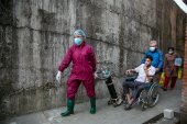 A COVID-19 patient arrives at a hospital in Kathmandu, Nepal [Niranjan Shrestha/AP]
