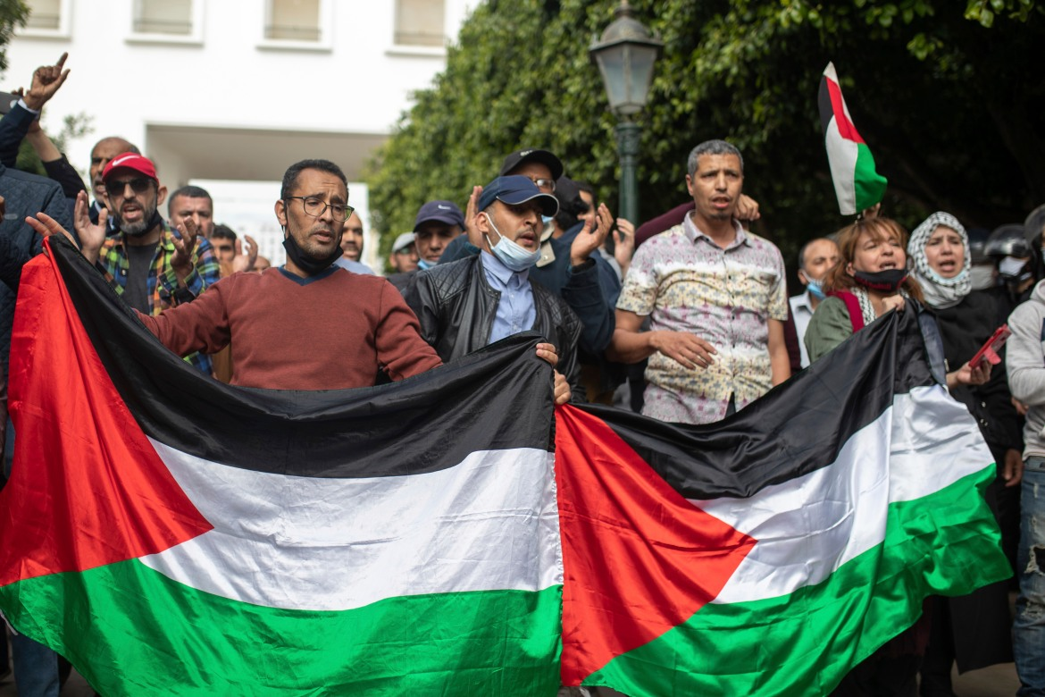 Protesters in Rabat carried Palestinian flags as they marched in Morocco's capital. [Mosa'ab Elshamy/AP Photo]