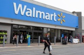 In February, Walmart said it would raise its average hourly wage to more than $15 per hour, a $1 increase [File: Brittany N. Gaddy/University of Maryland via AP]