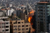 An Israeli airstrike hits the high-rise building housing Al Jazeera and The Associated Press' offices in Gaza City [Hatem Moussa/AP]