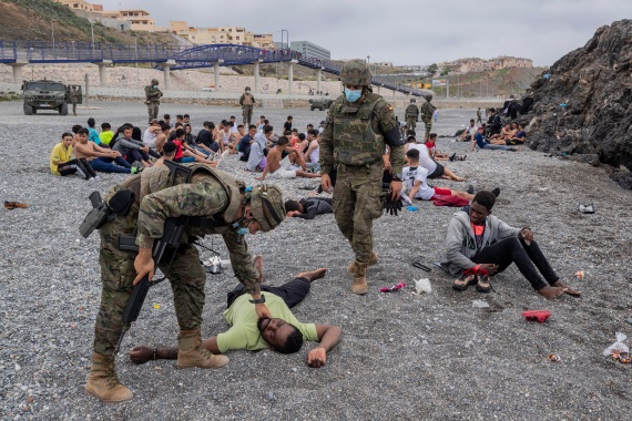 Social services for the small city perched on an outcropping in the Mediterranean buckled under the strain after more than 8,000 people crossed into Spanish territory during the previous two days. [Bernat Armangue/AP Photo]