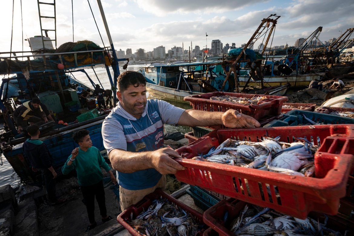 Israel has maintained a blockade on the Gaza Strip since 2007. It imposes tight restrictions on the work of fishermen off the coast of Gaza, citing security reasons. [John Minchillo/AP Photo]