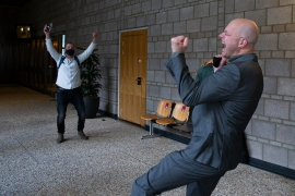 Milieudefensie director Donald Pols, right, celebrates the outcome of the verdict in the court case of Milieudefensie, the Dutch arm of the Friends of the Earth environmental organisation, against Royal Dutch Shell in The Hague, the Netherlands on Wednesday [Peter Dejong/AP]